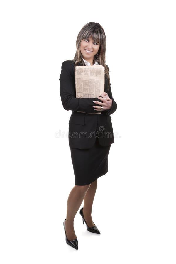 Jornal novo bonito da terra arrendada da mulher de negócios fotos de stock