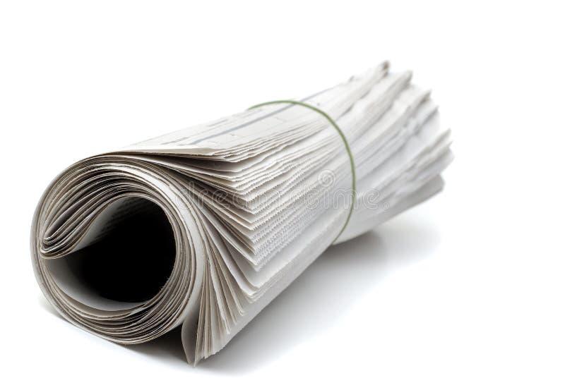 Jornal rolado acima imagens de stock royalty free