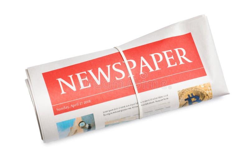 Jornal rolado no fundo branco imagem de stock