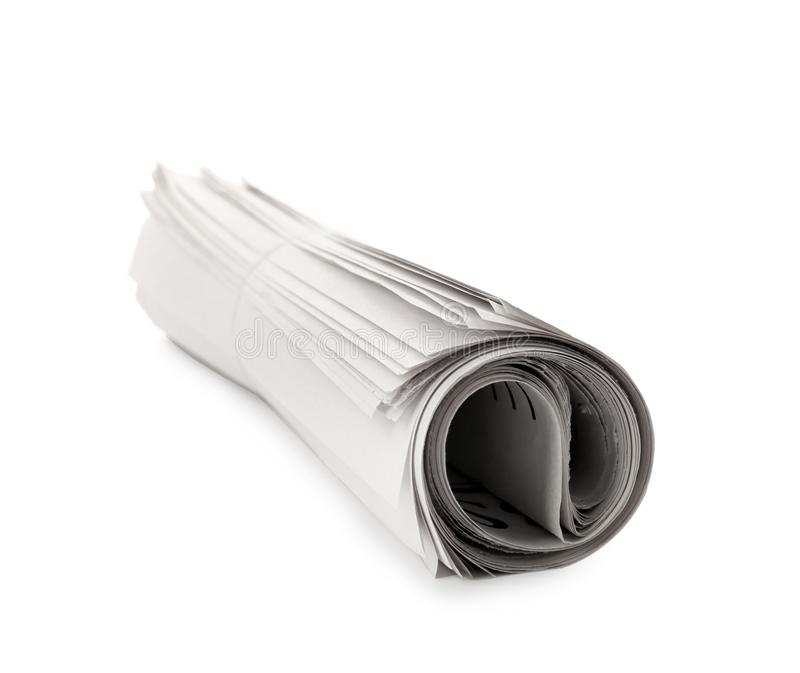 Jornal rolado no fundo branco imagem de stock royalty free