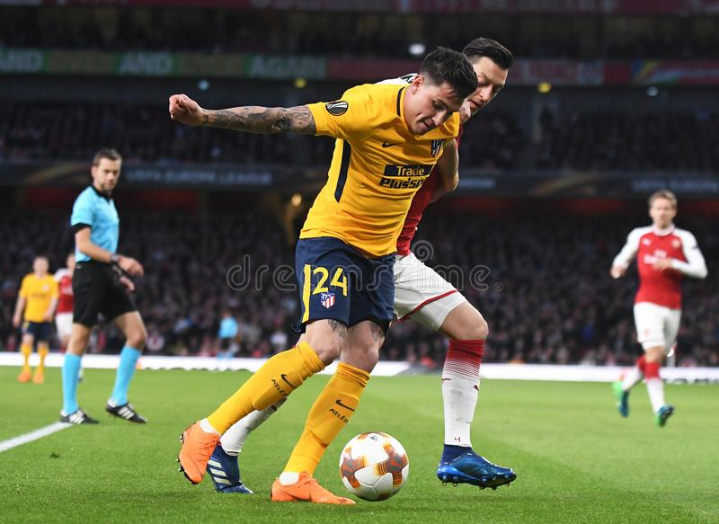 Jose Maria Gimenez and Mesut Ozil. Players pictured during the 2017/18 UEFA Europa League Semi-final 1st leg game between Arsenal FC and Atletico Madrid held on royalty free stock images