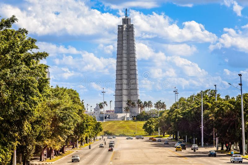 Jose Marti square view with monument, memorial tower and road wi. Th traffic in the foreground, Vedado district, Cuba, Havana royalty free stock photography