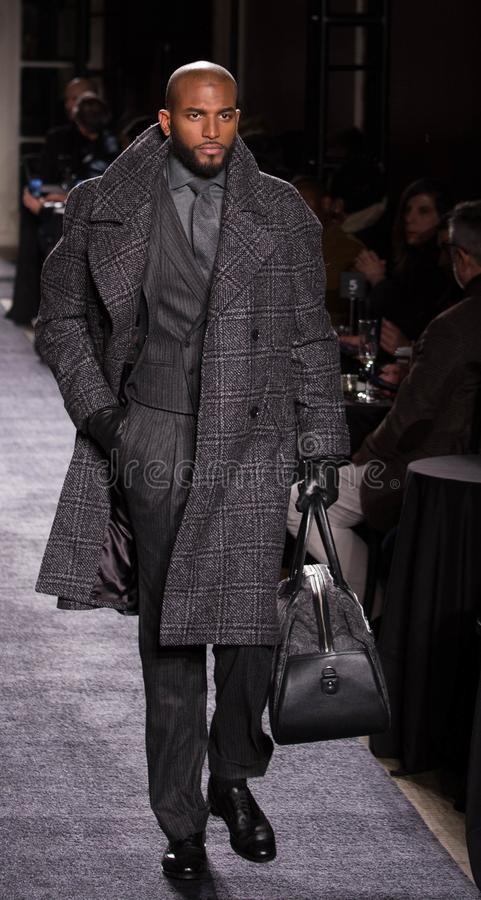 Joseph Abboud Men Winter collection during New York Fashion Week 2018. A model walks runway for Joseph Abboud Fall/Winter show during NY Fashion Week at Wolcott royalty free stock photo