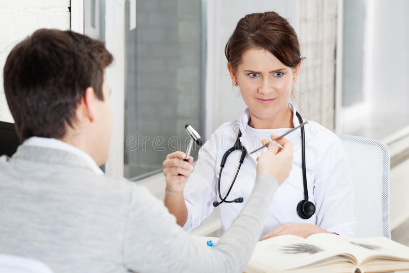 Joshing doctor. Patient joshing doctor with nail stock images