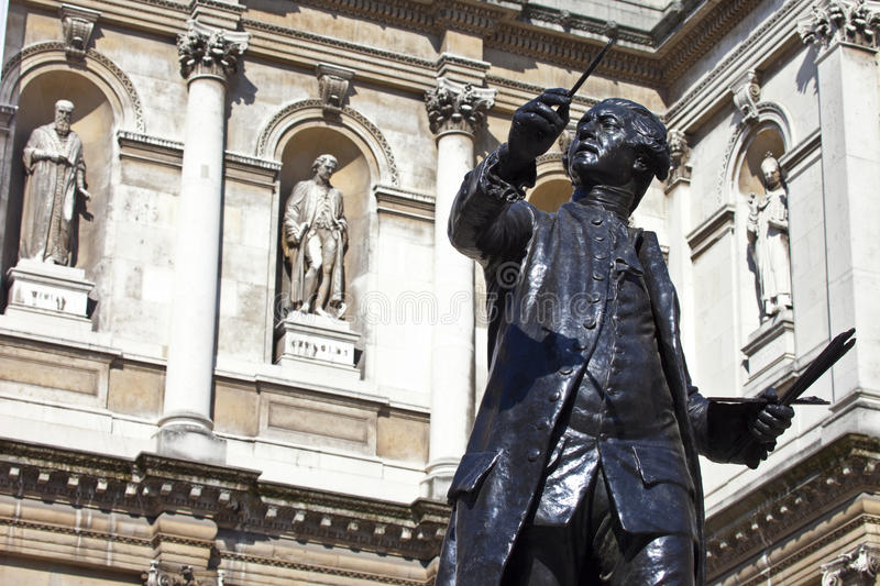 Joshua Reynolds Statue at Burlington House. Statue of English painter Joshua Reynolds situated at Burlington House which houses the Royal Academy of Art in royalty free stock images