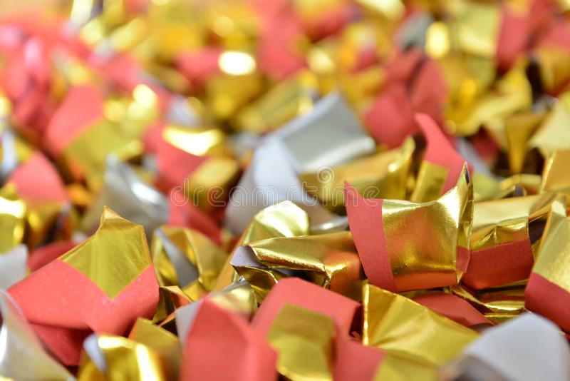 Joss paper gold and silver paper for worship with Joss Paper Chinese Tradition. Gold Paper folded for passed away ancestor`s royalty free stock photos