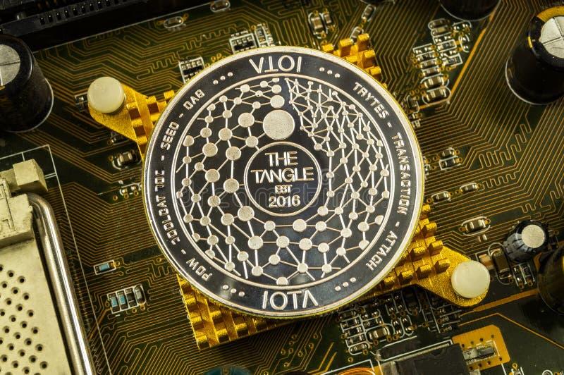 Jota is een moderne manier van uitwisseling en deze crypto munt stock fotografie