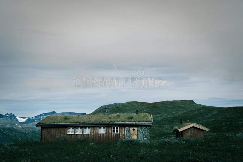 Traditional Norwegian huts in the mountain valley. Jotunheimen National Park landscape in Oppland, Norway. Traditional Norwegian huts in the mountain valley stock photography