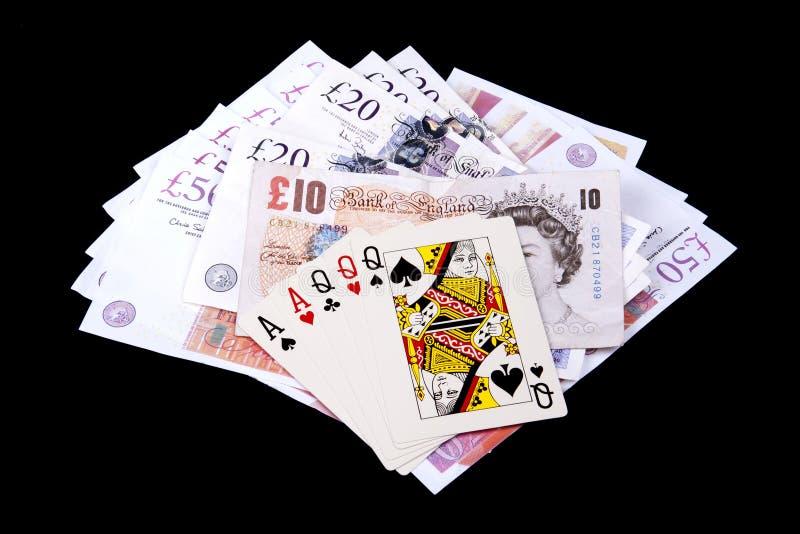 Jouer les cartes et l'argent photos stock