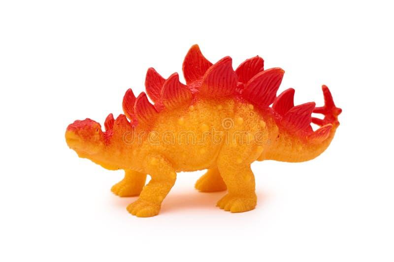 Jouet de dinosaure de silicone ou de plastique d'isolement sur le fond blanc image libre de droits