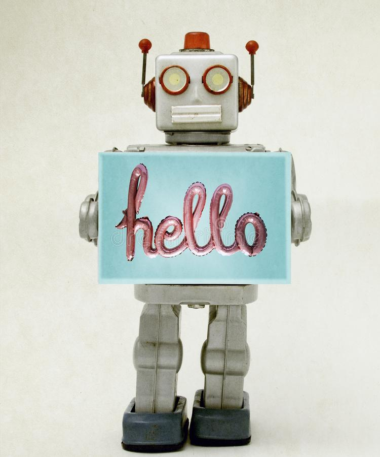 Jouet de robot tenant bonjour un signe photo stock