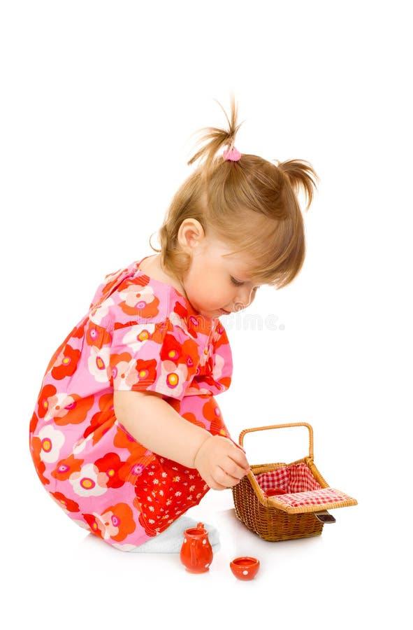 jouet de sourire rouge de robe de panier de chéri petit images libres de droits