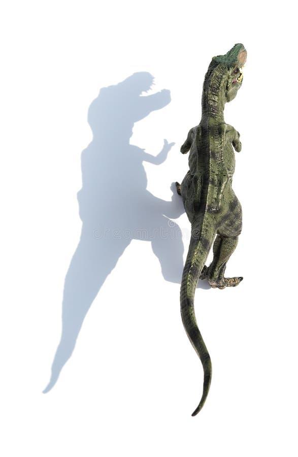 Jouet de tyrannosaure de vue supérieure avec l'ombre sur le blanc image libre de droits