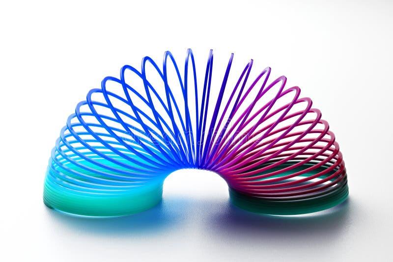 Jouet en plastique coloré de ressort image stock