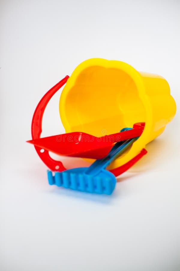 Jouets lumineux d'enfants pour jouer dans le bac ? sable images libres de droits