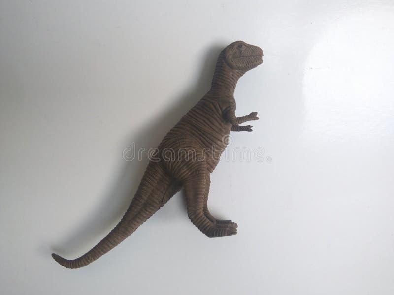 Jouets miniatures Tyrannosaurus Rex couleur brun image stock