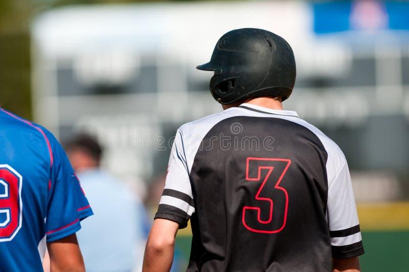 Joueur de baseball de lycée photo stock