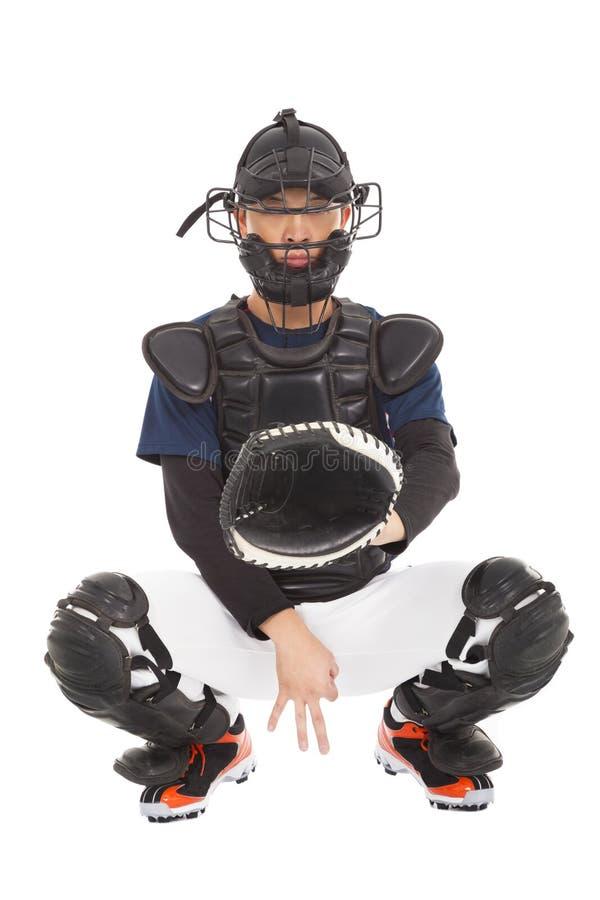 Joueur de baseball, receveur montrant le geste secret de signal image stock