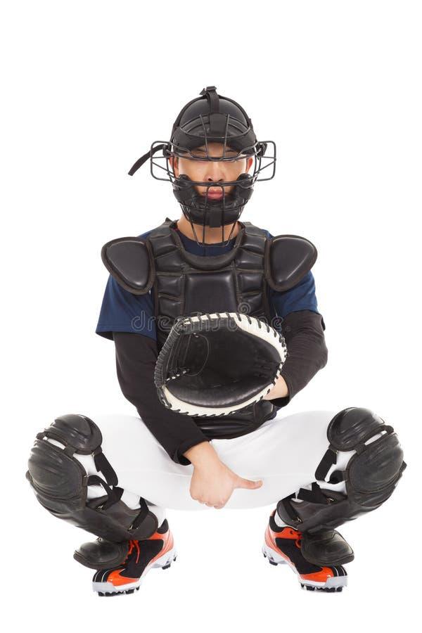 Joueur de baseball, receveur montrant le signal de secret de direction photographie stock