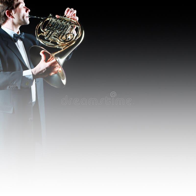 Joueur de cor d'harmonie photos stock