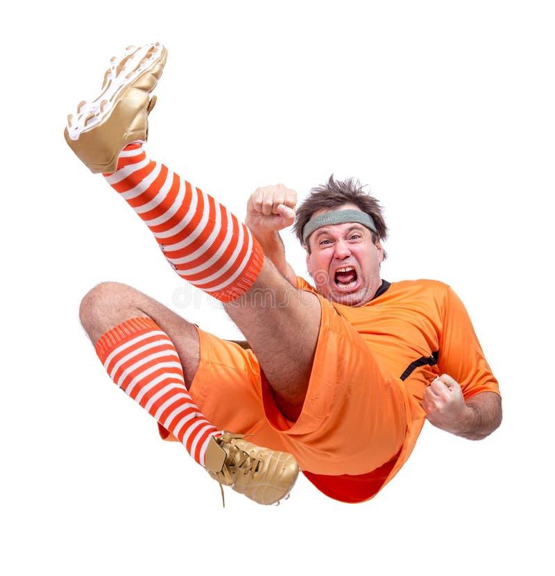 Joueur de football agressif du football photographie stock libre de droits