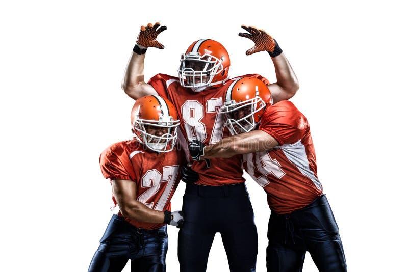 Joueur de football américain dans le blanc d'action d'isolement image libre de droits