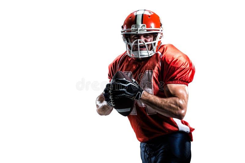 Joueur de football américain dans le blanc d'action d'isolement photo stock