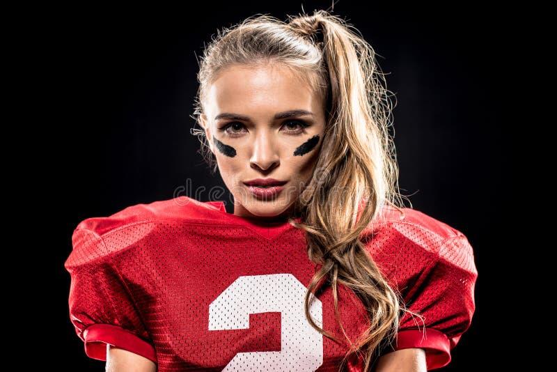 Joueur de football américain féminin attirant images stock