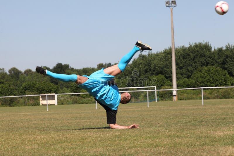 Joueur de football dans l'action photo stock