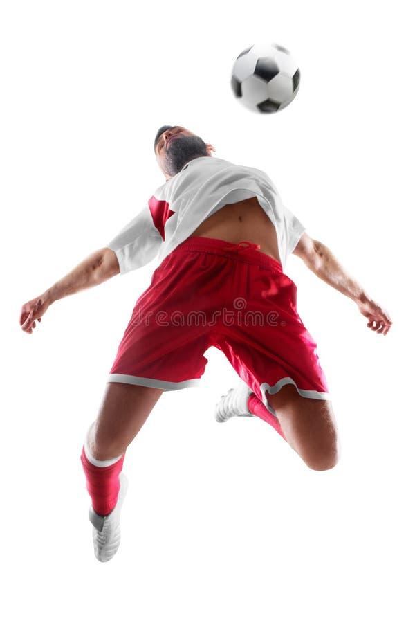 Joueur de football professionnel dans l'action Le footballer ruisselle avec la boule D'isolement sur le fond blanc image libre de droits