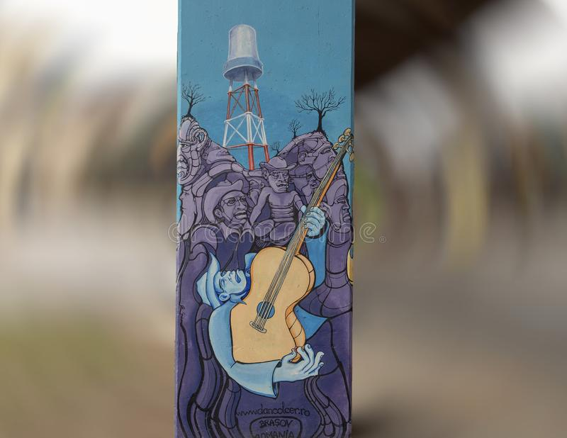 Joueur de guitare dans Art Park, Ellum profond, Dallas, le Texas images stock