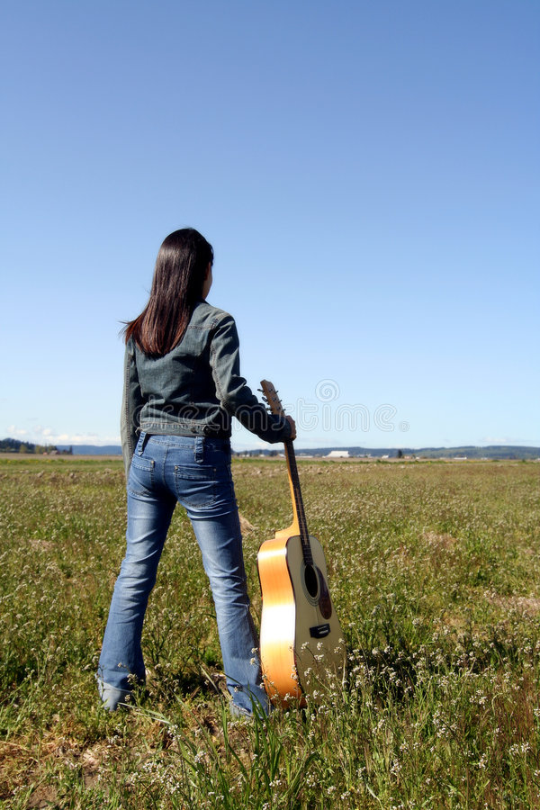Joueur de guitare de femme image stock