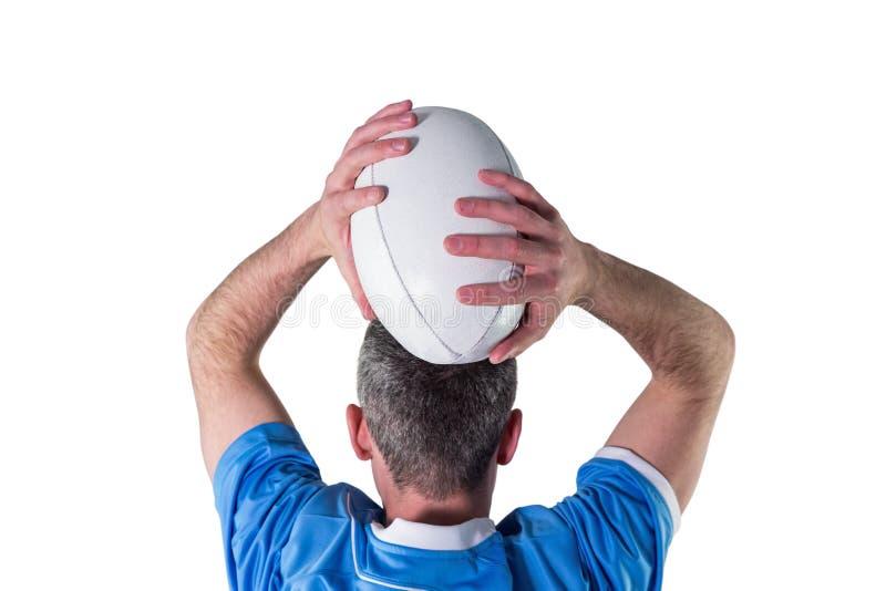 Download Joueur De Rugby Environ Pour Jeter Une Boule De Rugby Photo stock - Image du couvre, chaussure: 56486094