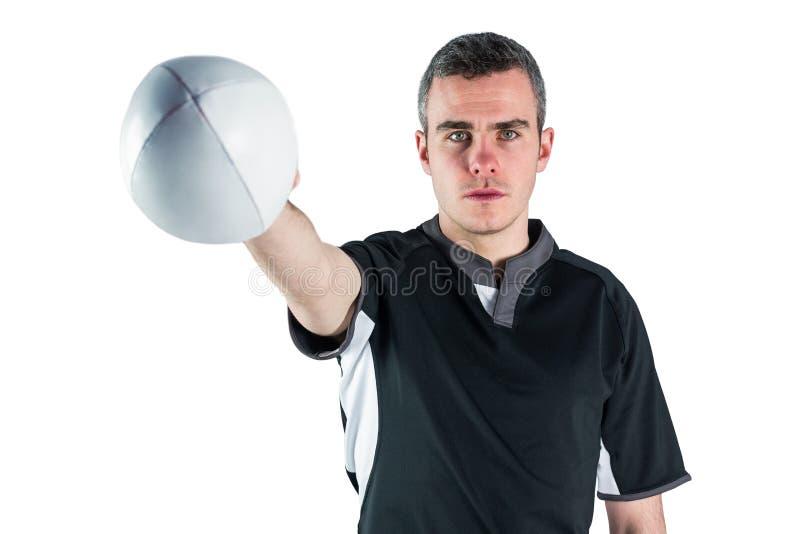 Download Joueur De Rugby Remettant Une Boule De Rugby Photo stock - Image du : 56486030