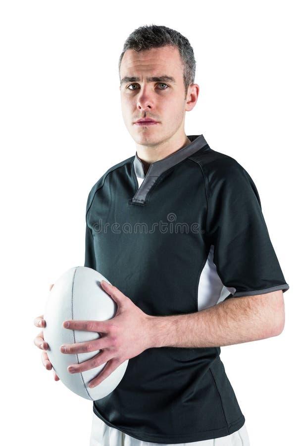 Download Joueur De Rugby Tenant Une Boule De Rugby Photo stock - Image du survêtement, bras: 56486058