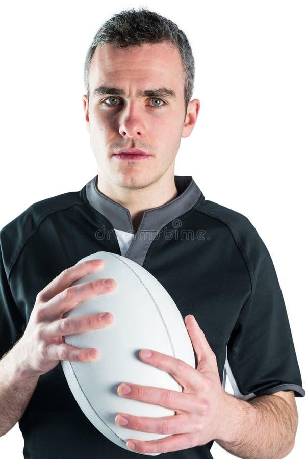 Download Joueur De Rugby Tenant Une Boule De Rugby Photo stock - Image du menton, professionnel: 56486068