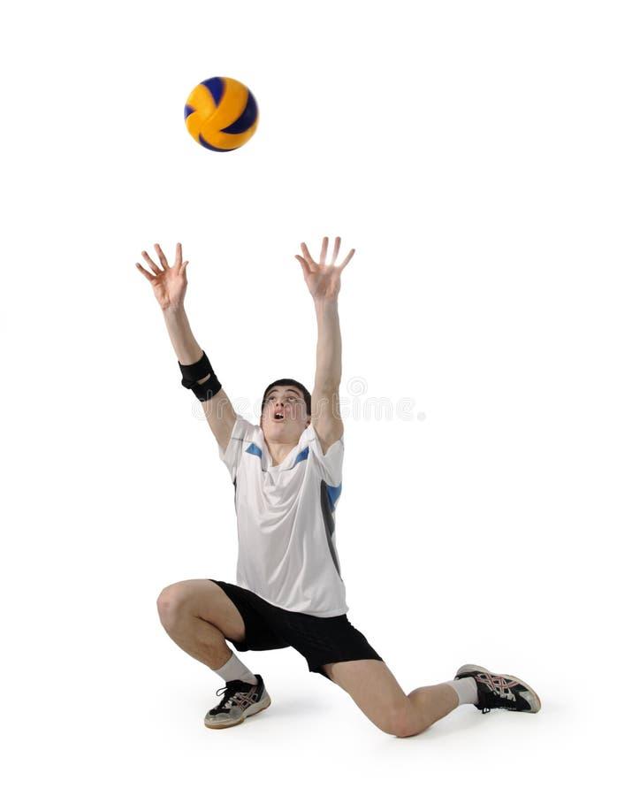 Joueur de volleyball avec la bille sur un blanc photographie stock