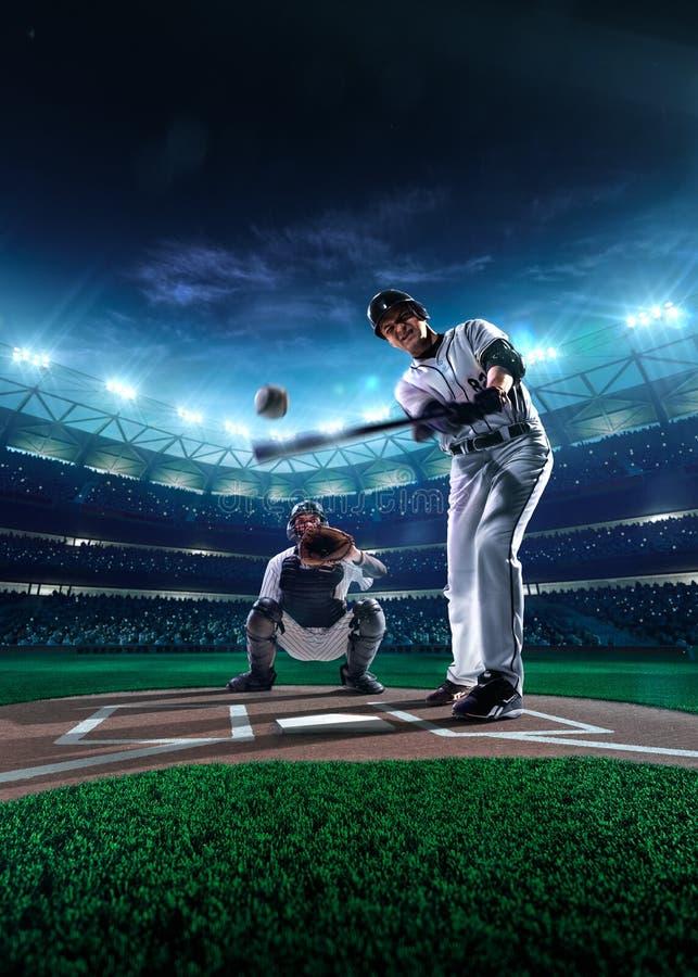 Joueurs de baseball professionnels sur l'arène grande photos stock