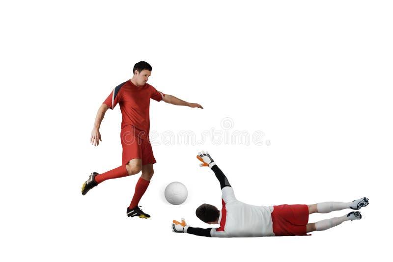 Joueurs de football abordant pour la boule photos libres de droits