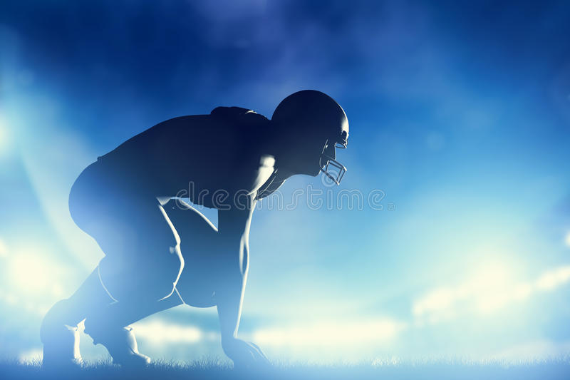 Joueurs de football américain dans le jeu Lumières de stade photo stock