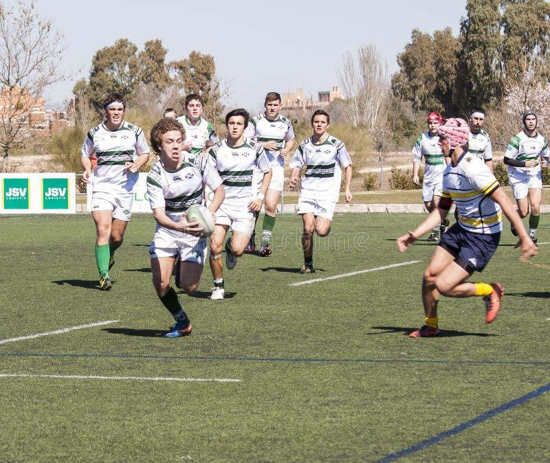 Joueurs de junior de rugby photographie stock libre de droits