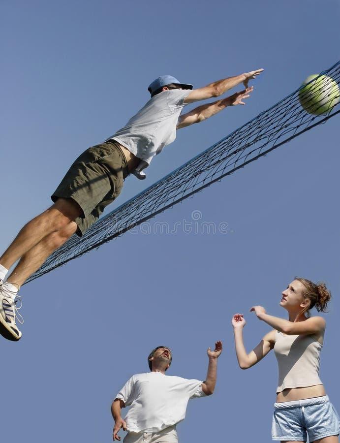 Joueurs de volleyball images libres de droits