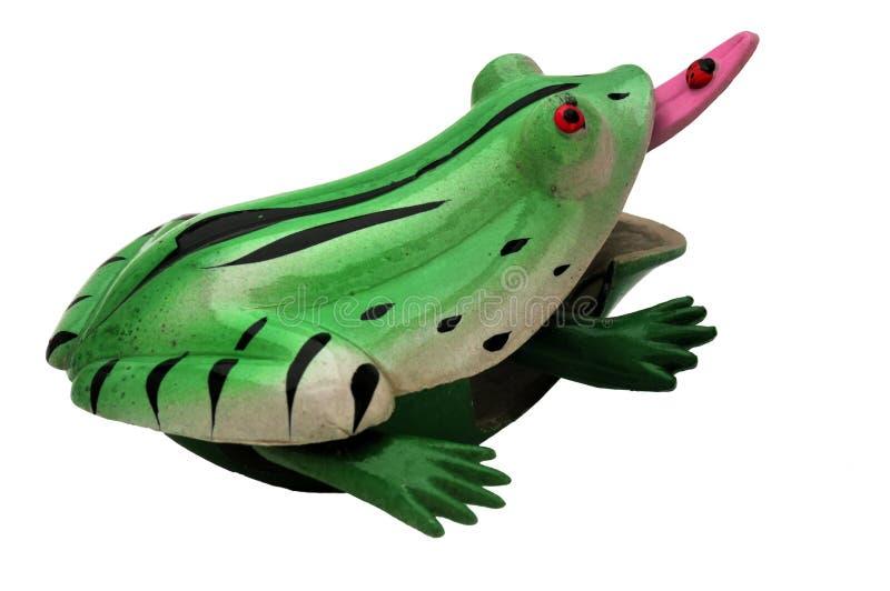Jouez la grenouille avec l'oeil rouge et la langue rose images libres de droits