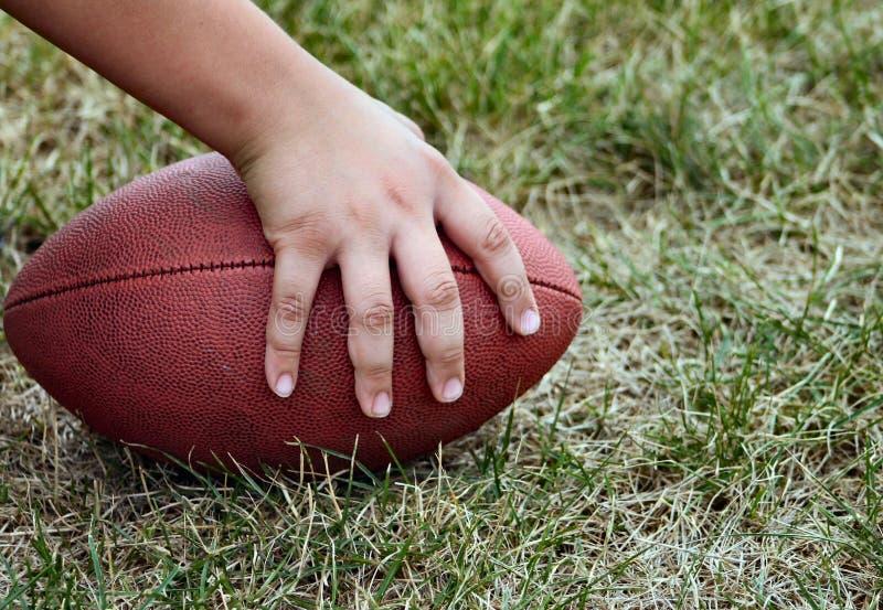 Jouons au football ! photographie stock libre de droits