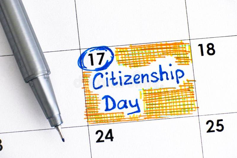Jour de citoyenneté de rappel dans le calendrier avec le stylo image libre de droits