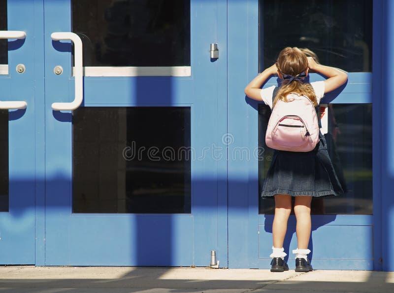 jour de fille d'école premier photos stock
