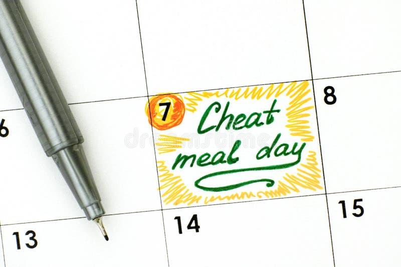 Jour de repas de fraude de rappel dans le calendrier avec le stylo vert photo stock