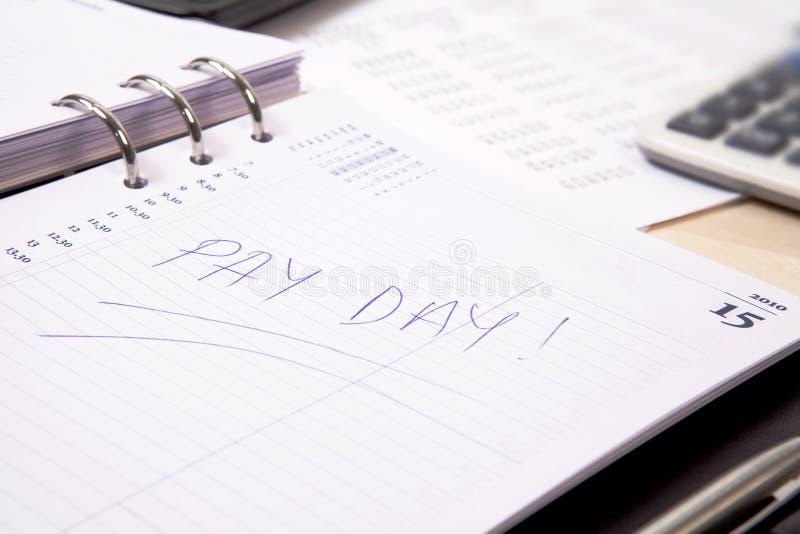 Jour de salaire photographie stock