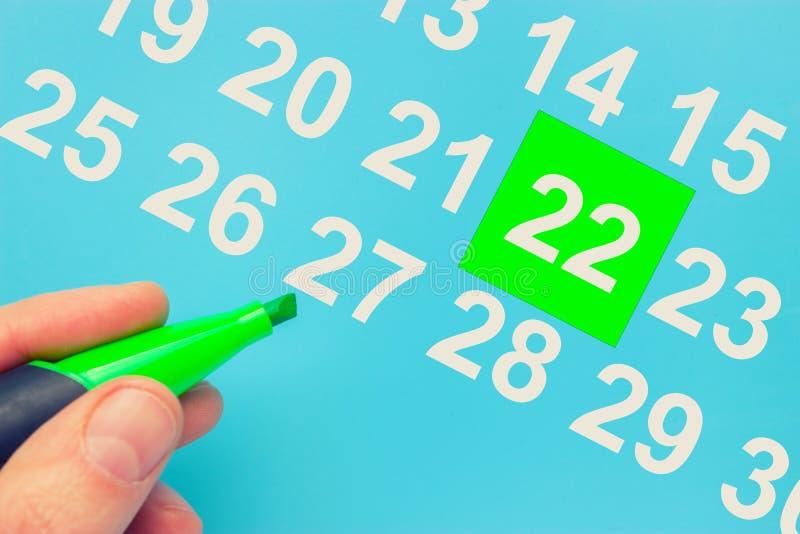 Jour de terre marqué sur le calendrier images stock