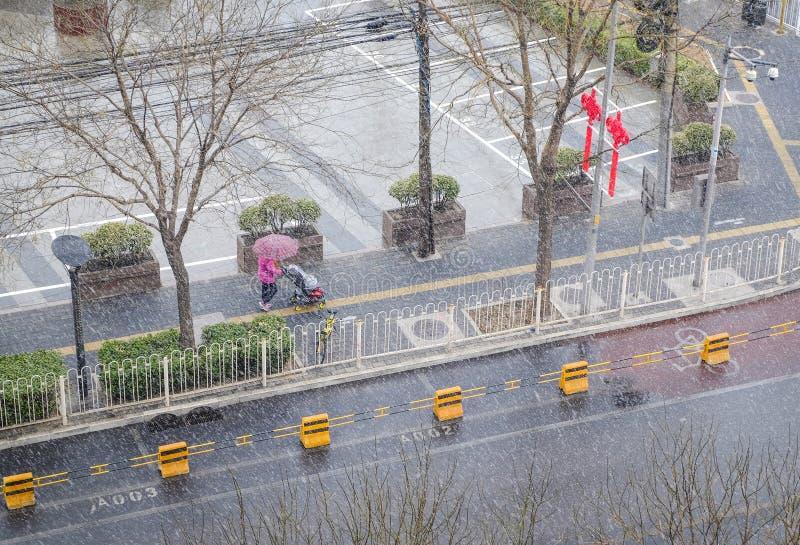 Jour neigeux rare dans le secteur de Chaoyang Pékin photographie stock libre de droits